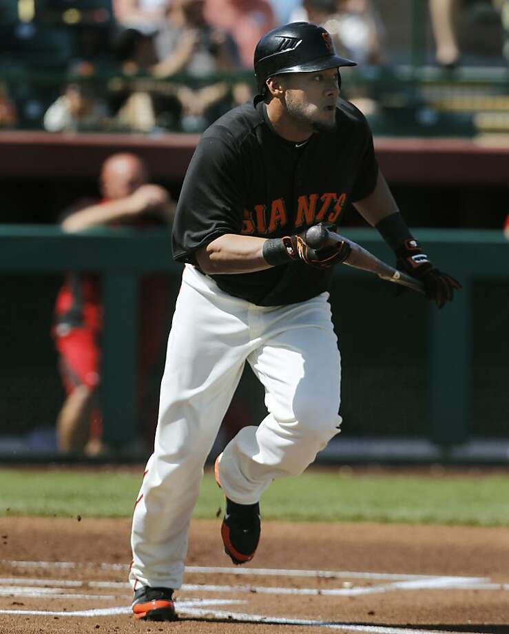 Melky Cabrera runs towards first base in the San Francisco Giants Cactus League spring training game against the Cincinnati Reds in Scottsdale, Ariz. on Friday, March 9, 2012. Photo: Paul Chinn, The Chronicle