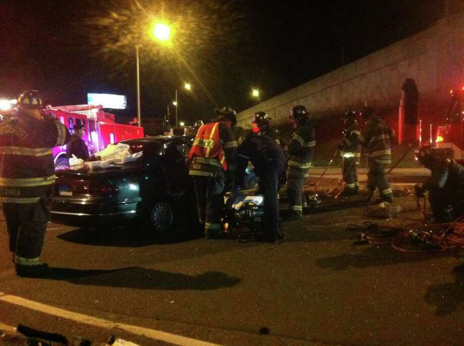 Three people were hospitalized with non-life threatening injuries after a three vehicle crash on Fairfield Avenue on Tuesday night, March 27, 2012 in Bridgeport. Photo: Tom Cleary