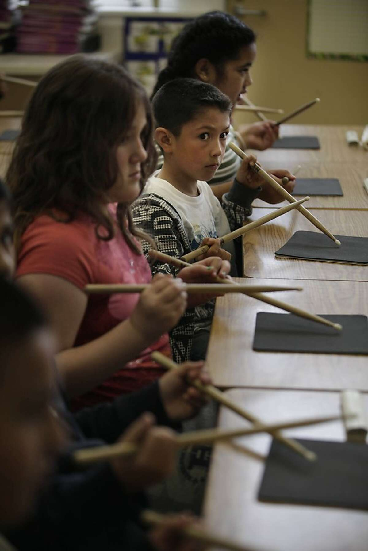 Allen Elementary school third grader Jaime Ortega (second from top) uses his drum sticks to drum notes as he keeps his eye on Endre Balogh (not shown), Toones Academic Music teacher, on Tuesday, March 27, 2012 in San Bruno, Calif.