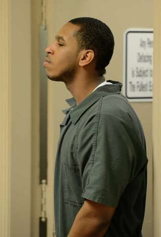 Dashaun Terry is lead to the Schenectady County Court in Schenectady, N.Y. March 27, 2012,  where he will be sentenced in the 2010 killing of his brother.     (Skip Dickstein / Times Union) Photo: SKIP DICKSTEIN / 00016976A