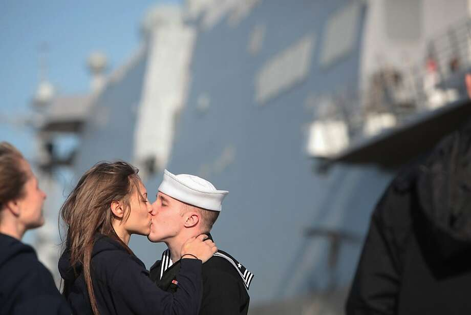 Marissa Shadler kisses boyfriend Cory Dutkiewicz goodby as he prepares to deploy on The USS New York, an amphibious transport dock ship, from Naval Station Norfolk in Norfolk, Va. on Tuesday, March 27, 2012. This is the first deployment of the ship, parts of which were built with steel from the World Trade Center. The New York is part of the Iwo Jima Amphibious Ready Group and will operate in the Mediterranean Sea and Arabian Gulf.  (AP Photo/The Virginian-Pilot, Steve Earley)   MAGS OUT Photo: Steve Earley, Associated Press