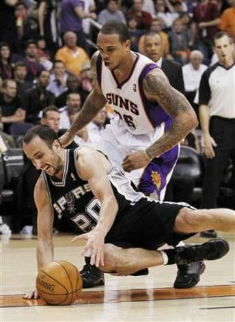 San Antonio Spurs' Manu Ginobili (20), of Argentina, dives for the ball in front of Phoenix Suns' Shannon Brown during the fourth quarter of an NBA basketball game Tuesday, March 27, 2012, in Phoenix.  The Spurs defeated the Suns 107-100.(AP Photo/Ross D. Franklin) (AP)
