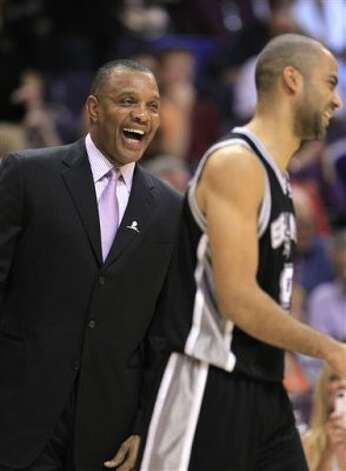 Phoenix Suns coach Alvin Gentry, left, laughs as he talks with San Antonio Spurs' Tony Parker, of France, before an NBA basketball game Tuesday, March 27, 2012, in Phoenix.(AP Photo/Ross D. Franklin) (AP)