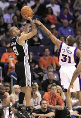 San Antonio Spurs' Tony Parker, of France, scores over Phoenix Suns' Sebastian Telfair (31) during the second quarter of an NBA basketball game Tuesday, March 27, 2012, in Phoenix.(AP Photo/Ross D. Franklin) (AP)
