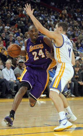 Kobe Bryant drives to the basket past Klay Thompson in the first half. The Golden State Warriors played the Los Angeles Lakers at Oracle Arena in Oakland, Calif,. on Tuesday, March 27, 2012. Photo: Carlos Avila Gonzalez, The Chronicle