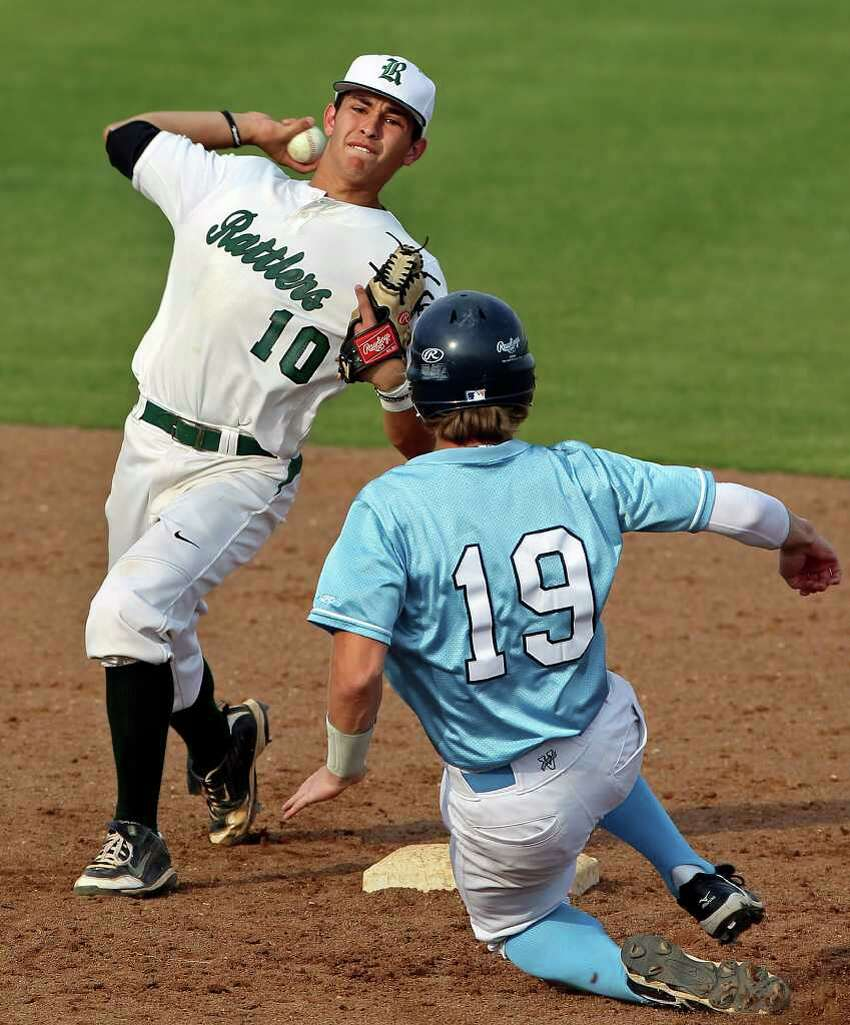 Reagan's Jason Sandoval gets the force out of Cody Dunlap at second and makes the throw to first to turn a double play in the fifth inning as Reagan beats Johnson 14-4 at Blossom baseball stadium on March 27, 2012. Tom Reel/ San Antonio Express-News