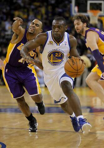 Warriors' rookie, Charles Jenkins dribbles past Lakers' Ramon Sessions, left, and Pau Gasol, right, in the second half. The Golden State Warriors played the Los Angeles Lakers at Oracle Arena in Oakland, Calif,. on Tuesday, March 27, 2012. The Lakers won 104-101. Photo: Carlos Avila Gonzalez, The Chronicle