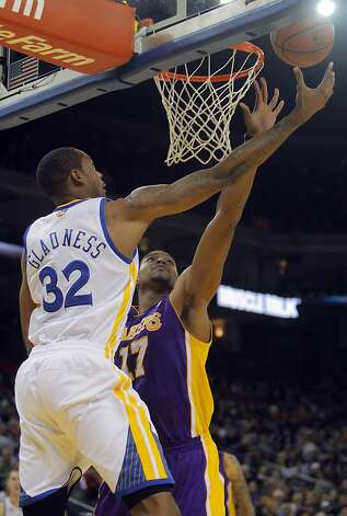 Warriors' Mickell Gladness puts up a shot defended by Lakers' Andrew Bynum in the second half. The Golden State Warriors played the Los Angeles Lakers at Oracle Arena in Oakland, Calif,. on Tuesday, March 27, 2012. The Lakers won 104-101. Photo: Carlos Avila Gonzalez, The Chronicle