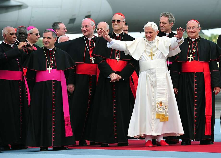 Pope Benedict XVI gestures upon arrival at the Jose Martí international airport in Havana, on March 27, 2012. Pope Benedict XVI, on the second day of a historic visit to Cuba, is to celebrate mass and possibly meet with the island's most famous inhabitant -- former president Fidel Castro. Photo: Alberto Pizzoli, AFP/Getty Images