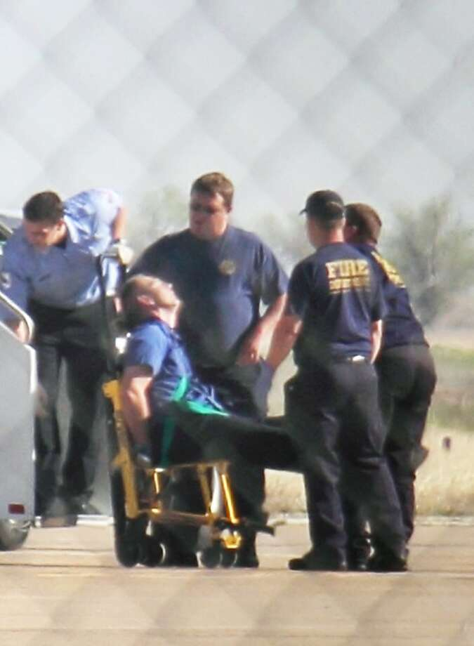 """Emergency workers tend to a JetBlue captain that had a """"medical situation"""" during a Las Vegas-bound flight from JFK International airport, Tuesday, March 27, 2012, in Amarillo, Texas. Passengers said the pilot screamed that Iraq or Afghanistan had planted a bomb on the flight, was locked out of the cockpit, and then tackled and restrained by passengers. The pilot who subsequently took command of the aircraft elected to land in Amarillo at about 10 a.m., JetBlue Airways said in a statement. Photo: Steve Douglas, Associated Press"""