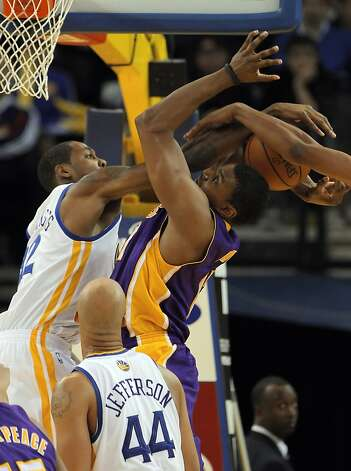 Warriors' Mickell Gladness fouls Lakers' Andrew Bynum in the second half. The Golden State Warriors played the Los Angeles Lakers at Oracle Arena in Oakland, Calif,. on Tuesday, March 27, 2012. The Lakers won 104-101. Photo: Carlos Avila Gonzalez, The Chronicle
