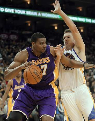Warriors' David Lee defends against Lakers' Andrew Bynum in the first half. The Golden State Warriors played the Los Angeles Lakers at Oracle Arena in Oakland, Calif,. on Tuesday, March 27, 2012. Photo: Carlos Avila Gonzalez, The Chronicle