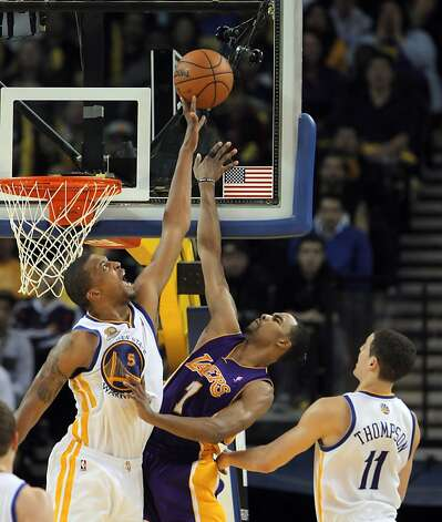Warriors' Dominic McGuire, left, blocks a shot by Lakers' Ramon Sessions, center in the second half. The Golden State Warriors played the Los Angeles Lakers at Oracle Arena in Oakland, Calif,. on Tuesday, March 27, 2012. The Lakers won 104-101. Photo: Carlos Avila Gonzalez, The Chronicle