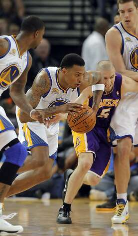 Brandon Rush drives past Lakers' Steve Blake in the first half. The Golden State Warriors played the Los Angeles Lakers at Oracle Arena in Oakland, Calif,. on Tuesday, March 27, 2012. Photo: Carlos Avila Gonzalez, The Chronicle
