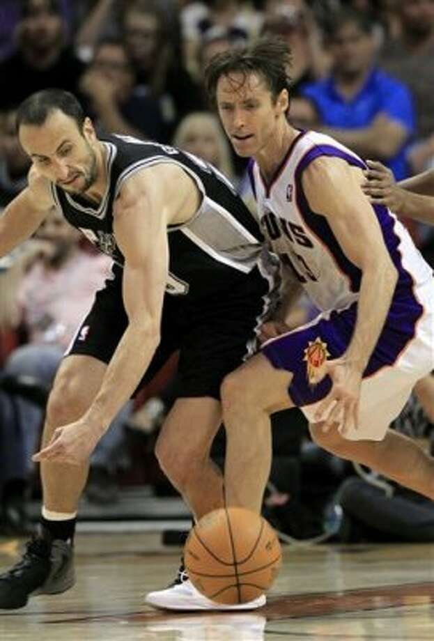 San Antonio Spurs' Manu Ginobili, left, of Argentina, strips the ball from Phoenix Suns' Steve Nash during the fourth quarter of an NBA basketball game Tuesday, March 27, 2012, in Phoenix.  The Spurs defeated the Suns 107-100.(AP Photo/Ross D. Franklin) (AP)