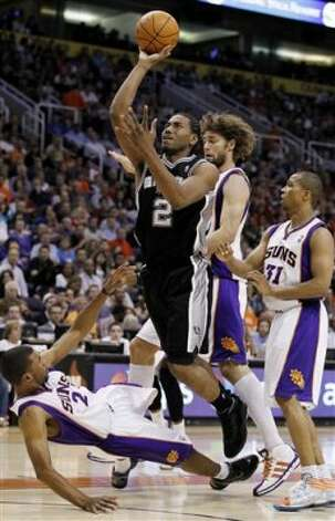 San Antonio Spurs' Kawhi Leonard (2) charges Phoenix Suns' Ronnie Price, left, as Suns' Sebastian Telfair (31) and Robin Lopez look on during the fourth quarter of an NBA basketball game Tuesday, March 27, 2012, in Phoenix.  The Spurs defeated the Suns 107-100.(AP Photo/Ross D. Franklin) (AP)