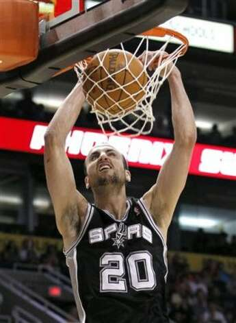 San Antonio Spurs' Manu Ginobili (20), of Argentina, dunks against the Phoenix Suns during the third quarter of an NBA basketball game Tuesday, March 27, 2012, in Phoenix.  The Spurs defeated the Suns 107-100.(AP Photo/Ross D. Franklin) (AP)