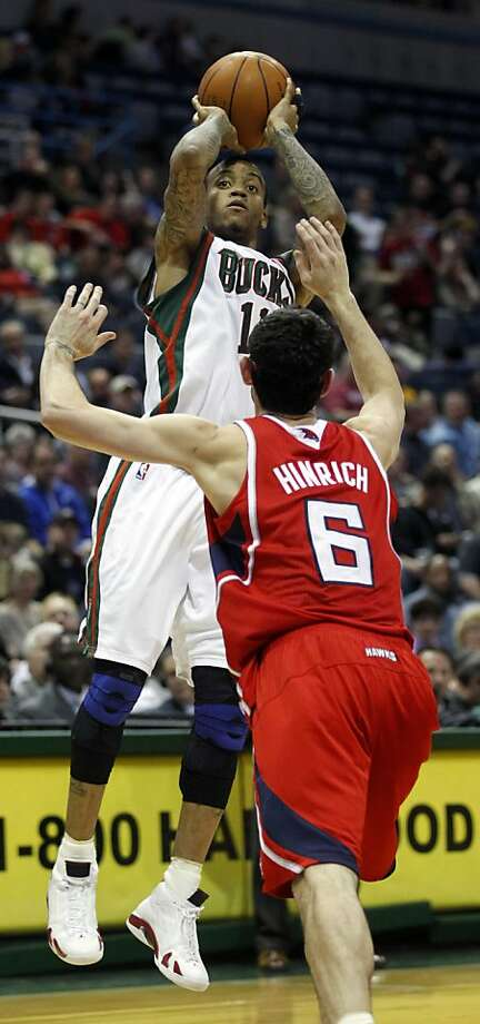 Milwaukee Bucks' Monta Ellis shoots over Atlanta Hawks' Kirk Hinrich (6) during the second half of an NBA basketball game, Tuesday, March 27, 2012, in Milwaukee. (AP Photo/Jeffrey Phelps) Photo: Jeffrey Phelps, Associated Press