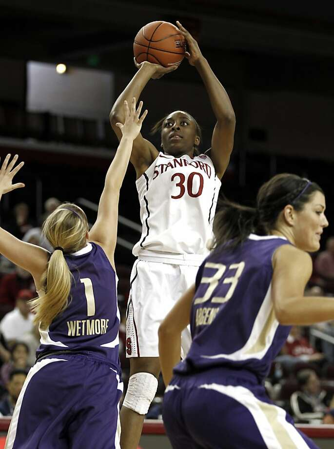 In this March 8, 2012 file photo, Stanford's Nnemkadi Ogwumike, center, takes a shot while being defended by Washington's Mercedes Wetmore, left, and Mackenzie Argens during the first half of an NCAA college basketball game at the Pac-12 Conference tournament in Los Angeles. Ogwumike was picked to The Associated Press' All-America team, Tuesday, March 27, 2012. Photo: Matt Sayles, Associated Press