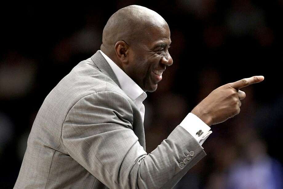 Hall of Famer Magic Johnson points toward the crowd during an NBA basketball game between the New York Knicks and the Cleveland Cavaliers at New York's Madison Square Garden, Wednesday, Feb. 29, 2012. (AP Photo/Kathy Willens) Photo: Kathy Willens, Associated Press