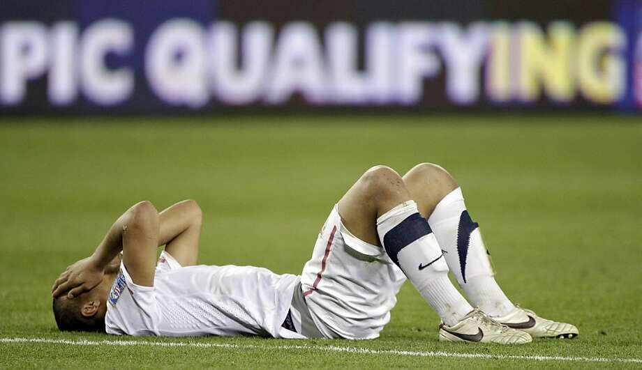 Terrence Boyd of the United States lies on the field after the United States tied 3-3 with El Salvador in a CONCACAF Olympic qualifying soccer match on Monday, March 26, 2012, in Nashville, Tenn. El Salvador scored in extra time to cause a 3-3 draw, eliminating the United States from Olympic qualifying. (AP Photo/Mark Humphrey) Photo: Mark Humphrey, Associated Press