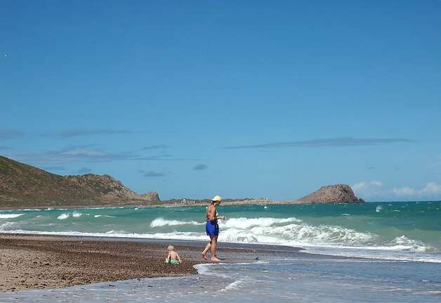 Visitors to the Cabo Pulmo shoreline enjoy the clear waters and nearly empty beach. Photo: Christine Delsol, Special To SFGate