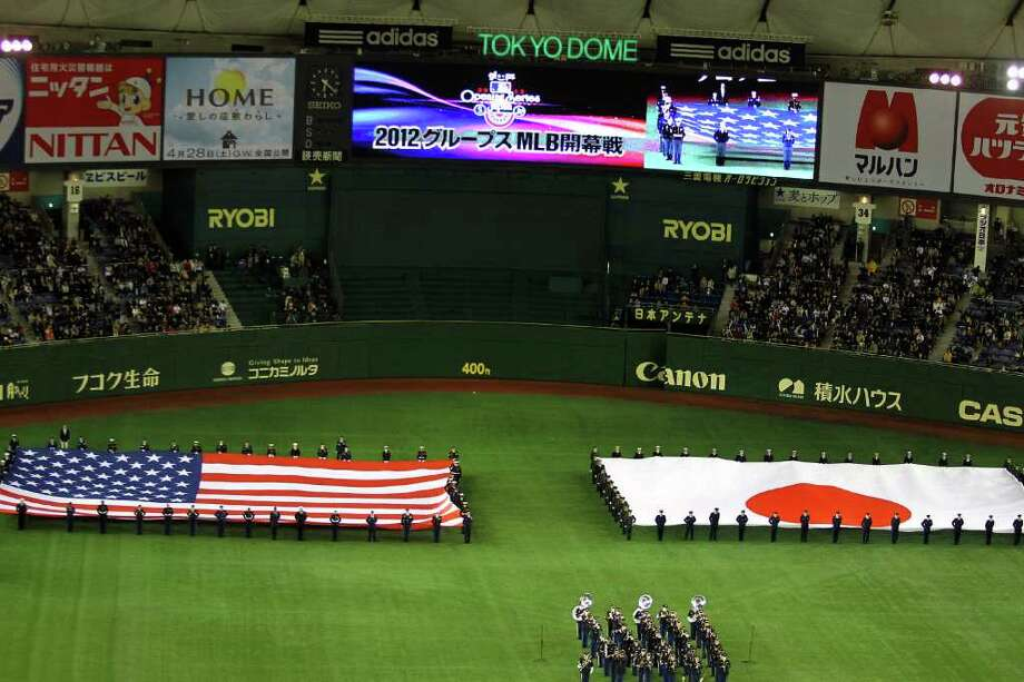 TOKYO, JAPAN - MARCH 28: line up for national anthem during MLB match between Seattle Mariners and Oakland Athletics at Tokyo Dome on March 28, 2012 in Tokyo, Japan. Photo: Koji Watanabe, Getty Images / 2012 Getty Images