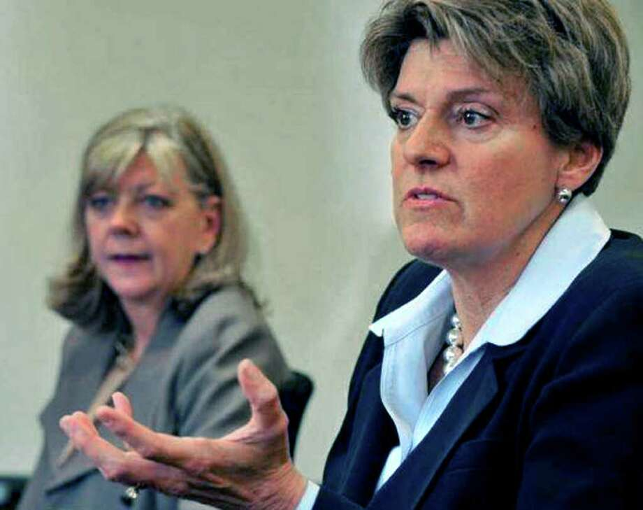 SPECTRUM/Deborah Weymouth, right, the senior vice president of operations at Western Connecticut Health Network and executive director of New Milford Hospital, explains the planned closing of the hospital's birthing center. Lisatening in is Andrea Rynn, WCHN's public relations director.  Photography by Jason Rearick Photo: Contributed Photo