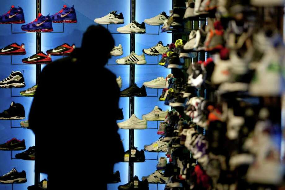 A customer shops for athletic shoes at a Modell's retail location in Times Square in New York, U.S., on Tuesday, March 27, 2012. Manufacturers in the U.S. probably received more orders for durable goods in February and consumer purchases climbed the most in five months, economists said reports this week will show. Photographer: Scott Eells/Bloomberg Photo: Scott Eells, Bloomberg / © 2012 Bloomberg Finance LP