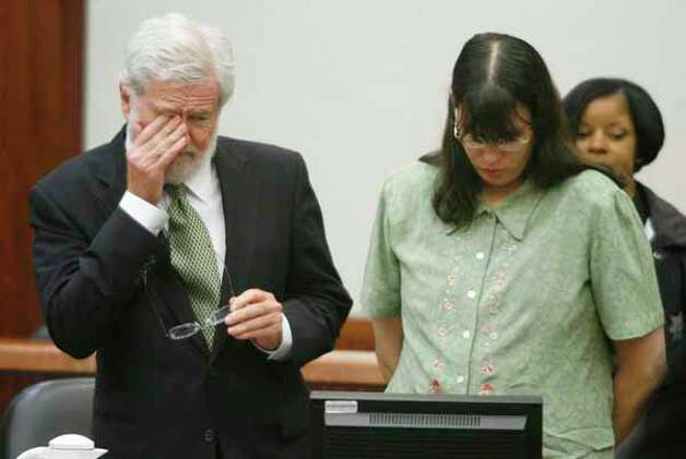 Defense attorney George Parnham, left, and his client Andrea Yates stand as the jury leaves the courtroom following closing arguments in her second murder trial, Monday, July 24, 2006, in Houston. Yates, charged in the 2001 drowning deaths of her five children in the bathtub, has pleaded of innocent by reason of insanity. Yates, 42, was convicted of murder in 2002 an