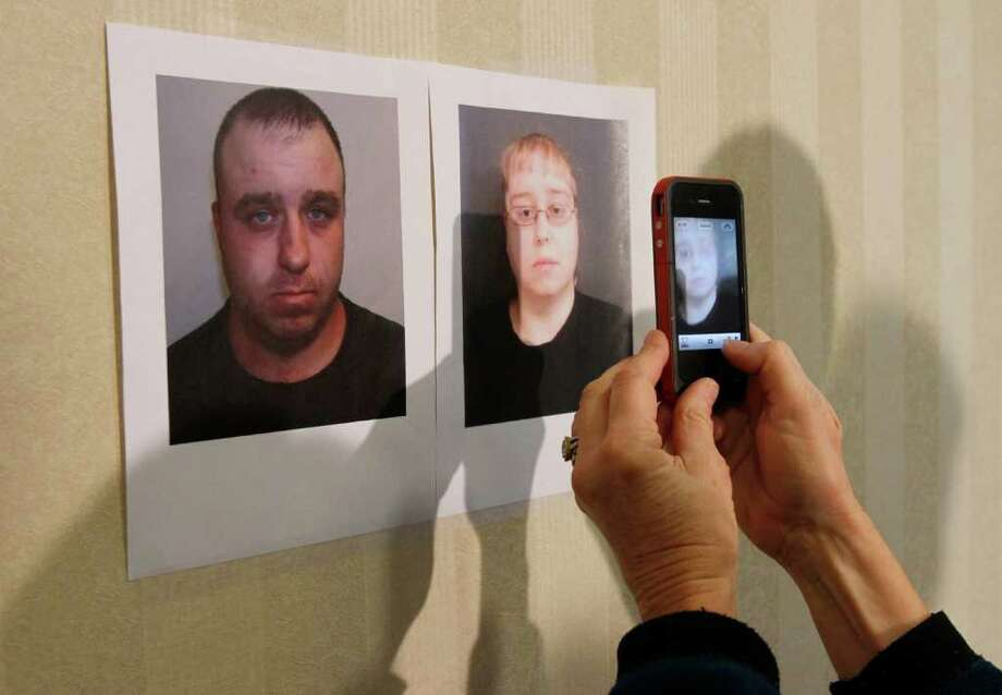 A reporter takes a photo of booking photos of Allen and Patricia Prue at a news conference Wednesday, March 28, 2012 in St. Johnsbury, Vt. Allen and Patricia Prue are being charged in connection with the killing of Vermont prep school teacher Melissa Jenkins, who police say was strangled. Thirty-year-old Allen Prue of Waterford, Vt., and his 33-year-old wife Patricia Prue are facing 2nd degree murder charges in connection with the killing of  Jenkins.(AP Photo/Toby Talbot) Photo: Toby Talbot