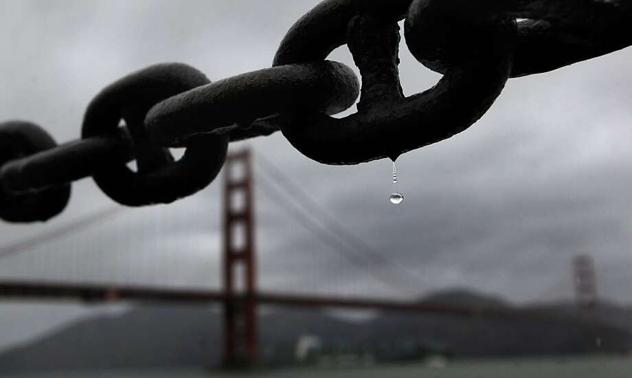 Raindrops fall from the rusted chains along Fort Point as wet weather begins to move across the Bay Area,  beginning to soak the Golden Gate Bridge, on Tuesday March 27, 2012, in San Francisco, Ca. Photo: Michael Macor, The Chronicle