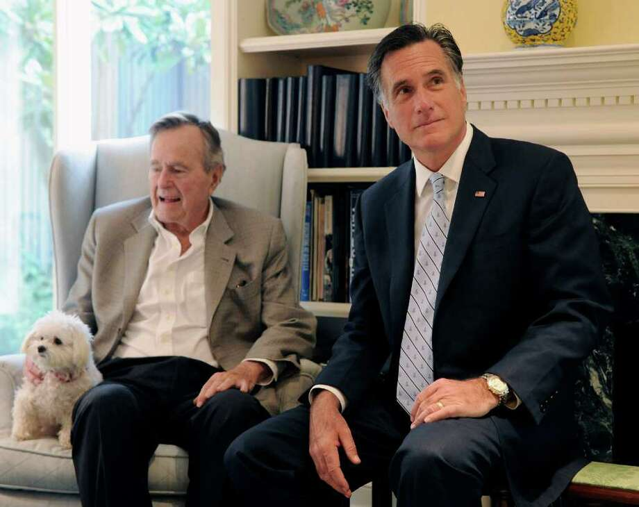 FILE - In this Dec. 1, 2011 file photo, Republican presidential candidate, former Massachusetts Gov. Mitt Romney meets with former President George H.W. Bush in Houston. The former president plans to endorse Mitt Romney, further urging the Republican Party to coalesce around the former Massachusetts governor's presidential campaign. (AP Photo/Pat Sullivan) Photo: Pat Sullivan, STF / AP