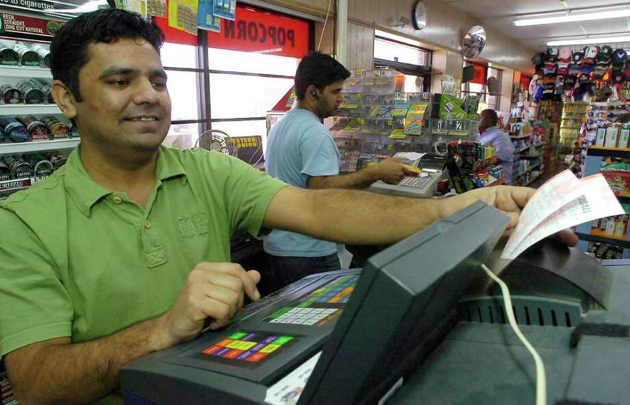 Muhammad Bashir, one of the daytime managers at B&B Mini Mart, rings up Mega Millions Lotto Tickets last year. The jackpot for this Friday is a record $476 million.   Dave Ryan/The Enterprise / Beaumont