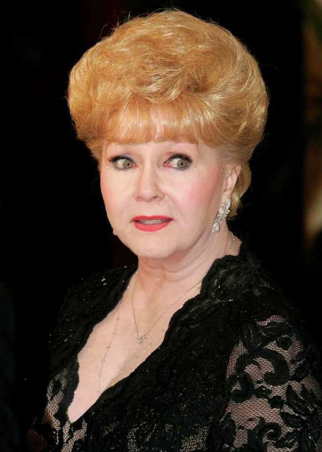 Actress Debbie Reynolds arrives for Elizabeth Taylor's 75th birthday party at the Ritz-Carlton, Lake Las Vegas in Henderson, Nevada February 27, 2007. REUTERS/Steve Marcus (UNITED STATES) Photo: STEVE MARCUS, REUTERS / X00642