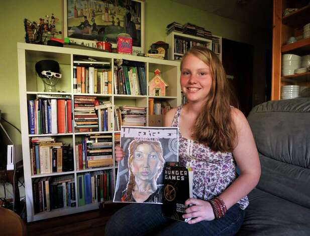 "Eilish Nobes, 15, of Danbury, is halfway through illustrating her graphic novel based on the book and movie, ""The Hunger Games."" Nobes is seen here at her home in Danbury on Tuesday, March 27, 2012. Photo: Jason Rearick / The News-Times"