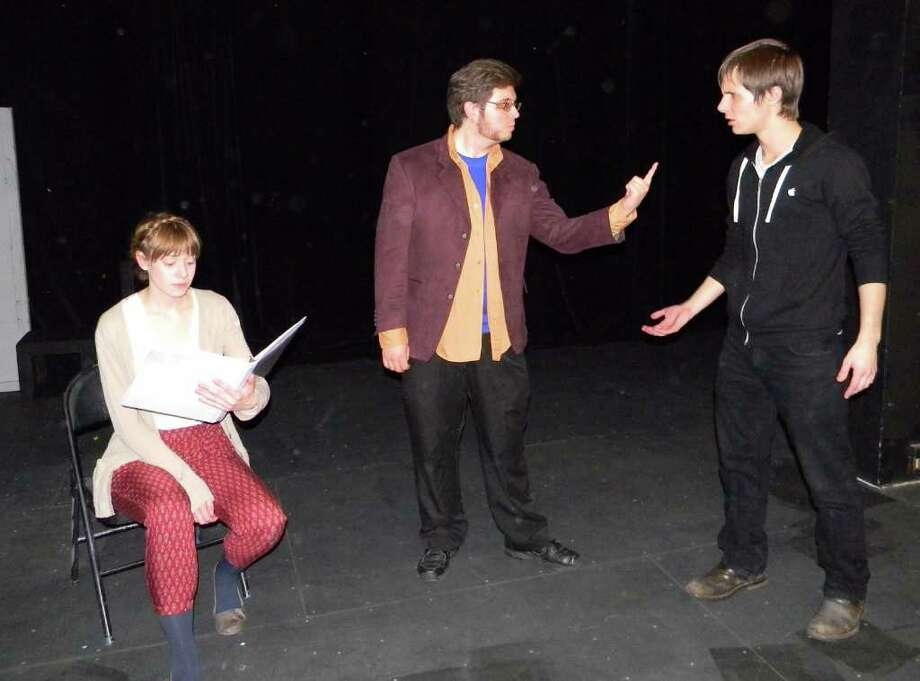 Evan Jones photo Rehearsing their parts for the upcoming ??Plays in Process?? staged readings at the University at Albany are, from left, Cecelia Gray, Martin Cahill and Nick Brigadier.
