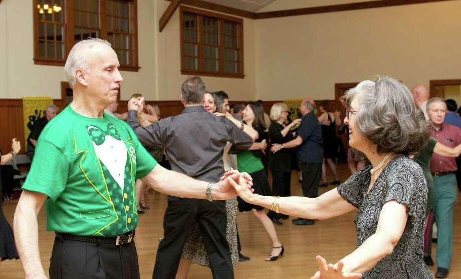 "Ballroom dancing is alive and well in Greenwich. Here, Greenwich resident Suzy Simpson takes a turn around the dance floor with dance teacher Ed Poska at the Round Hill Community House, which holds ballroom dancing events on alternating Saturdays.  ""Ballroom dance,"" says Simpson, ""brings the romance back."" Photo: Jean-Francois Bulycz"