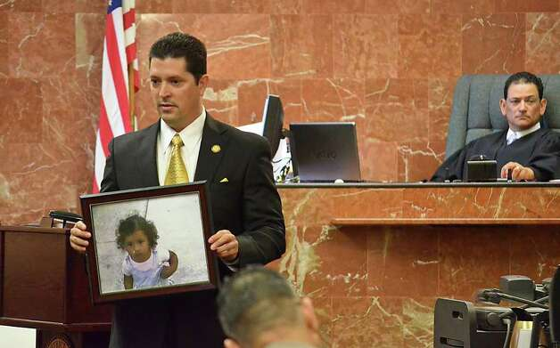 "District Attorney Isidro Alaniz shows the jury a photo of the late Katherine Cardenas during the trial of Jose ""Lalo"" Eduardo Arredondo at the 49th District Court, Wednesday morning. Photo: Danny Zaragoza / LAREDO MORNING TIMES"