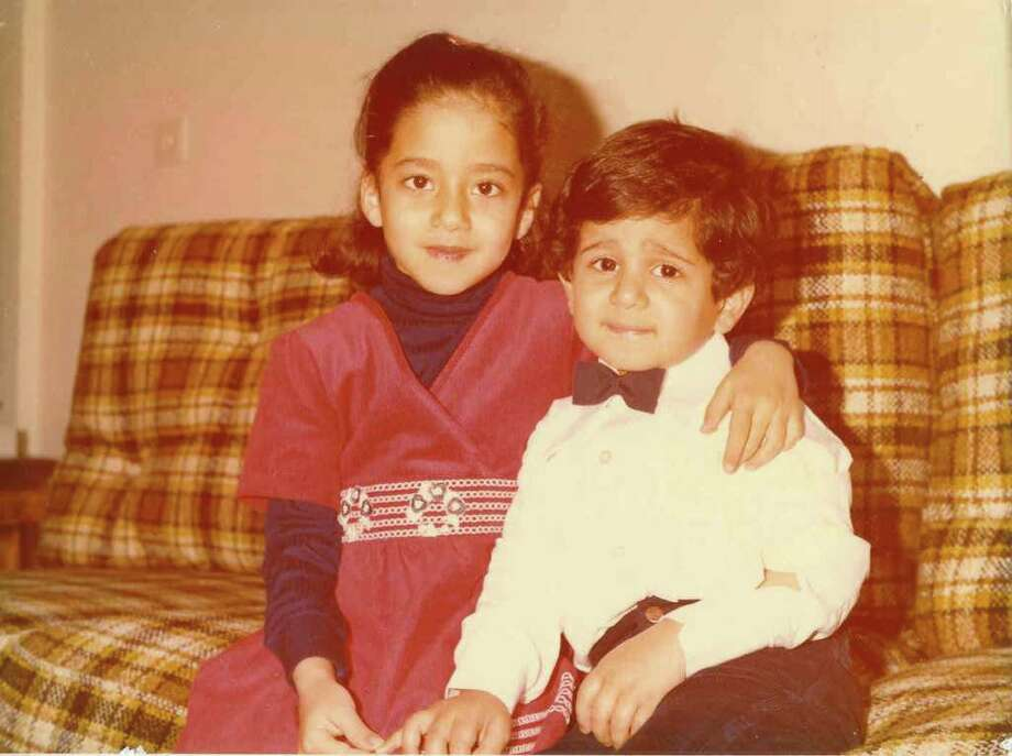 Shiva Sarram, left, and her brother, Bahman, witnessed war first hand in Iran before leaving in the late '70s when Shiva was 6 years old. Photo: Contributed Photo