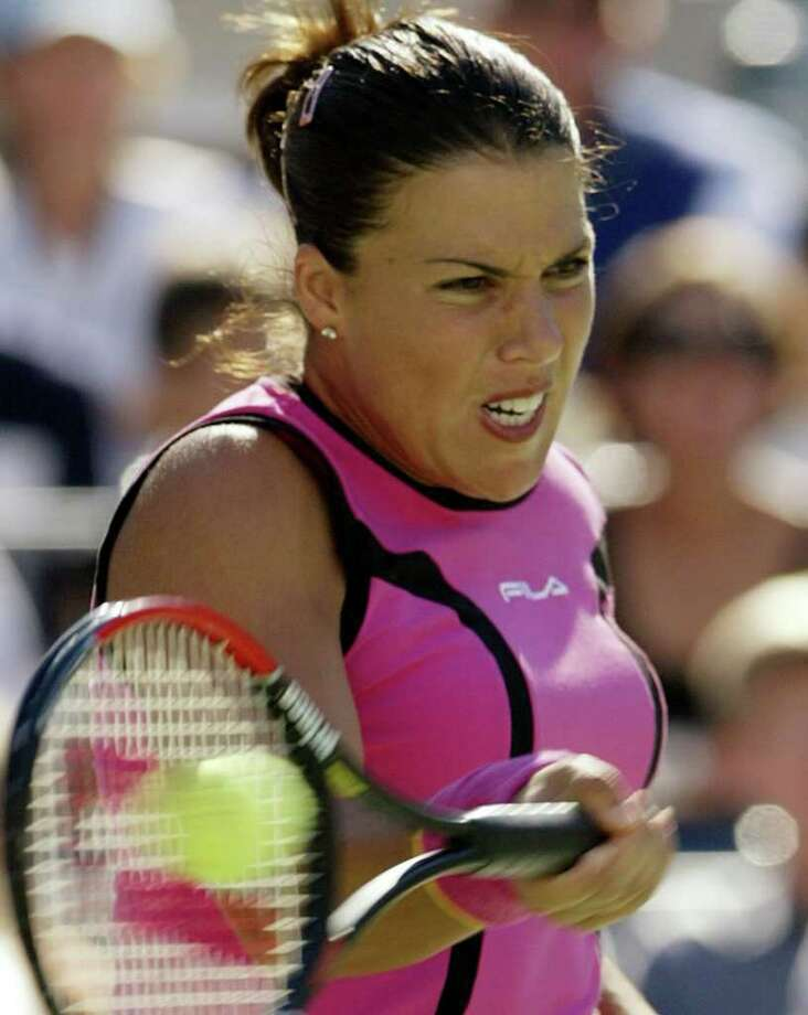 (FILES)Eighth seed Jennifer Capriati of the US makes a return to sixth seed Elena Dementieva of Russia during a women's semi-finals at the US Open in Flushing Meadows, New York 10 September 2004. Former world number one Jennifer Capriati has been hospitalised in Florida following a suspected drugs overdose, the TMZ.com entertainment website reported on June 28, 2010. AFP PHOTO/Mandel NGAN/FILES (Photo credit should read MANDEL NGAN/AFP/Getty Images)(Photo Credit should Read /AFP/Getty Images) Photo: MANDEL NGAN / AFP
