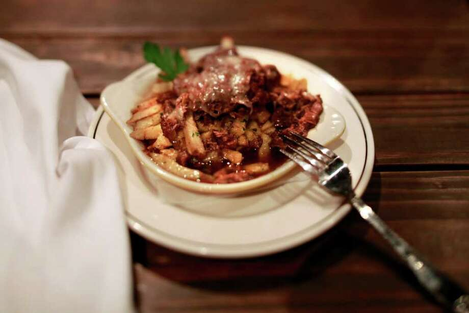 Kings Row Gastropub in Pasadena, California, serves Cheeky Bastard Poutine, a dish with beef cheek cooked in ale over hand-cut fries. Beef cheek is one of the trendy ingredients that may soon disappear from menus as the next big thing comes along. (Jay L. Clenenin/Los Angeles Times/MCT) Photo: Jay L. Clendenin / Los Angeles Times