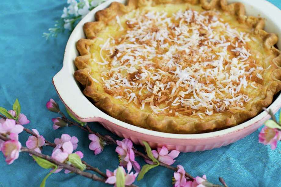 Coconut cream pie is magical, with its homemade flaky crust and rich silky custard.  (AP Photo/Matthew Mead) Photo: Matthew Mead