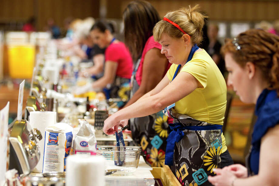 In this image released by General Mills, contestant Christina Verrelli, of Devon, Pa., bakes during the 45th Pillsbury Bake-Off Contest at the Peabody Orlando Hotel, Monday, March 26, 2012, in Orlando, Fla. Photo: Todd Rosenberg, AP / Copyright Todd Rosenberg Photography 2010