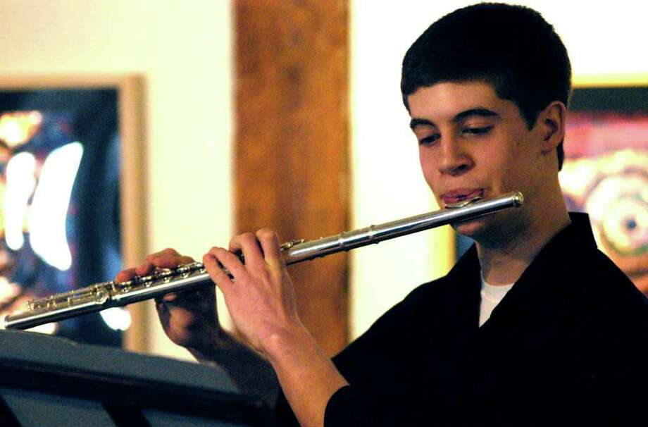 SPECTRUM/Accompanied by pianist Amy Vinisko, New Milford High School junior Thomas Barkal shares his ability on the flute with patrons of the season's opening concert featuring NMHS students active in Hunt Hill Farm's new talent music initative. March 11, 2012. Photo: Norm Cummings
