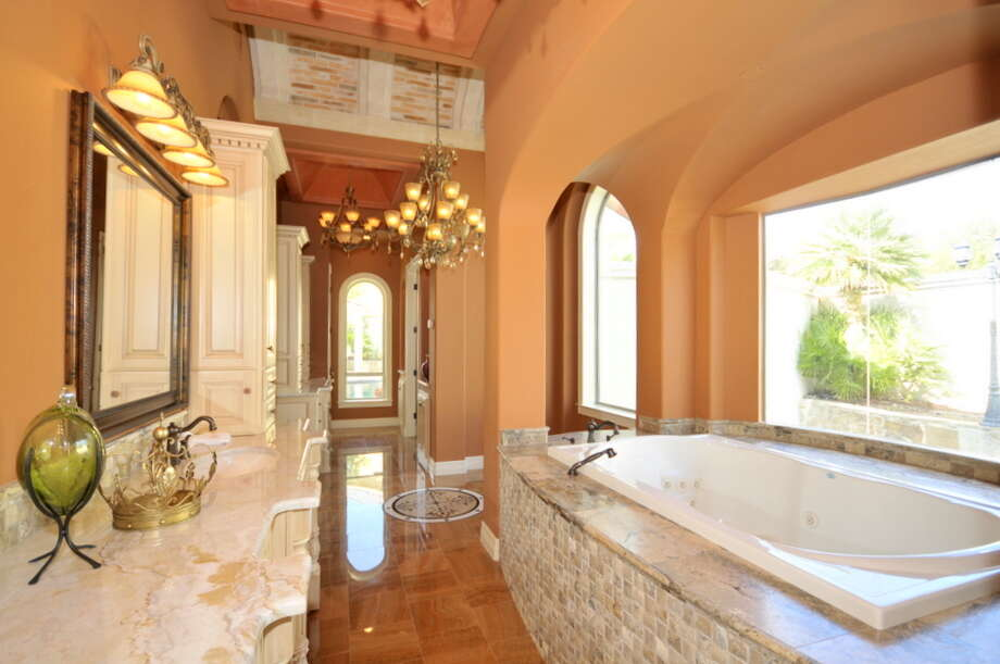 The bathroom is among the most popular areas of the home for remodeling and renovation, according to the new design trends survey from the American Institute of Architects. The home in The Dominion is listed for $1.5 million. Photo: COURTESY PHOTO / courtesy of Keller Williams Heritage