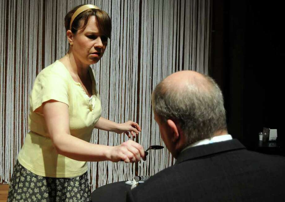 Jean (Jennifer Decker) embarks on a strange cellphone journey when she takes Gordan's (Mark Roberts) phone after he dies in a restaurant. Photo: Dave Rossman / © 2012 Dave Rossman
