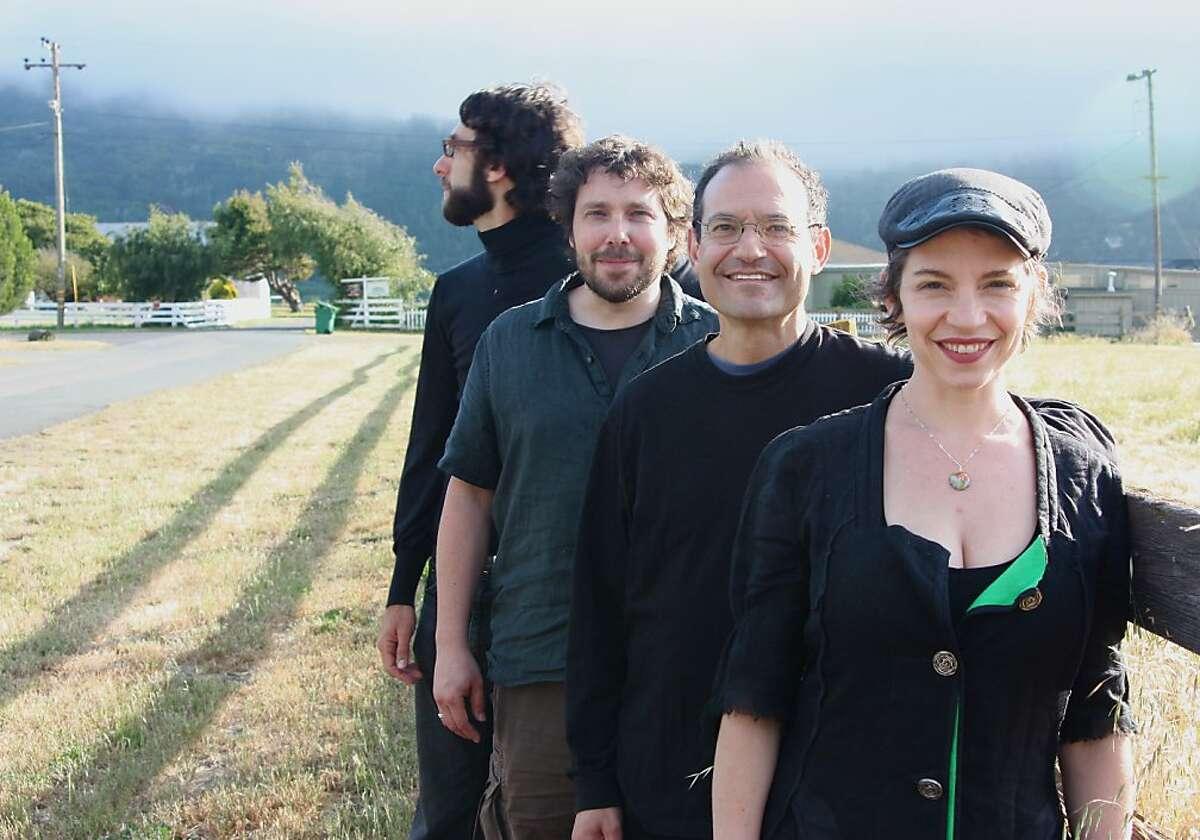 Members of Tin Hat: Carla Kihlstedt violin, voice Mark Orton guitar, dobro Ben Goldberg clarinets Rob Reich accordion, piano
