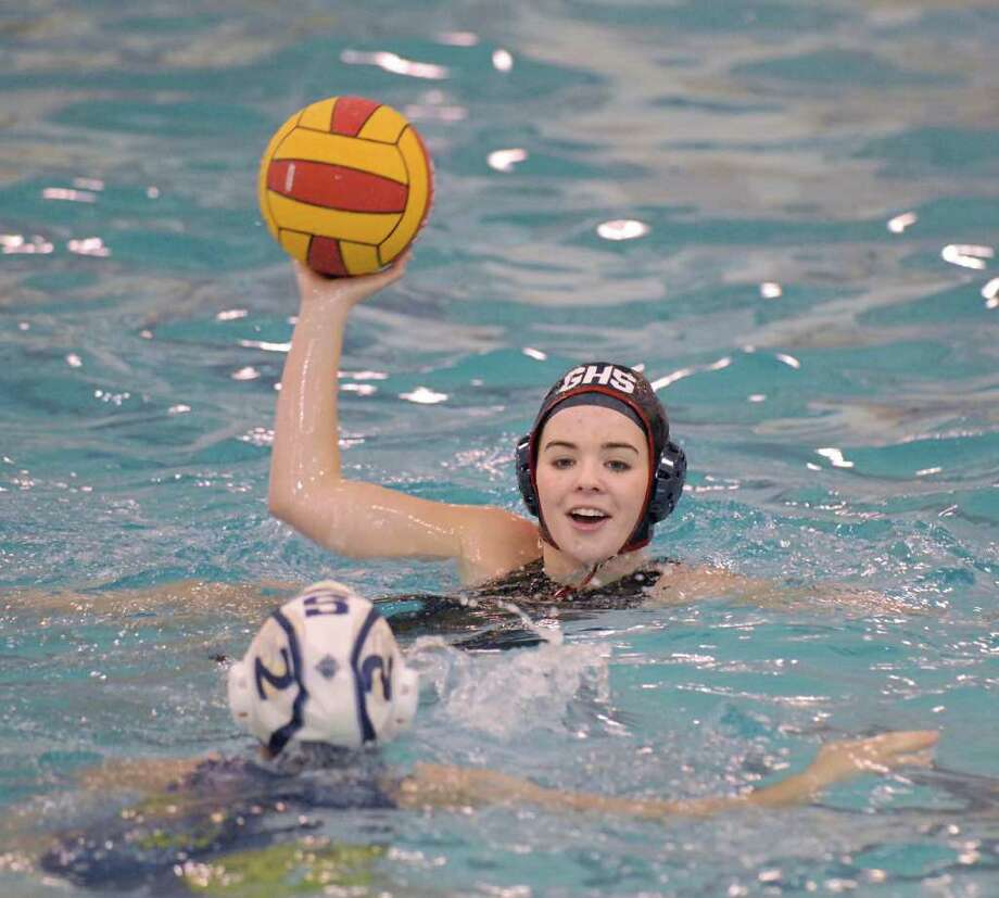 Milena Meehan, background of Greenwich, looks to pass while being covered by Maddy McCartin # 2 of Staples during girls high School water polo match between Greenwich High School and Staples High School at Greenwich, Wednesday, March 28, 2012. Photo: Bob Luckey / Greenwich Time