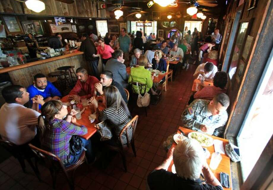 The interior of Good Time Charlie's is small but effective. The popular restaurant is the winner of the inaugural Burger Madness tournament.  (Bob Owen / San Antonio Express-News)